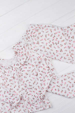 Pajama set with floral print. Jacket with ruffle collar, pants with elastic waistband. New girls sleepwear arrival.