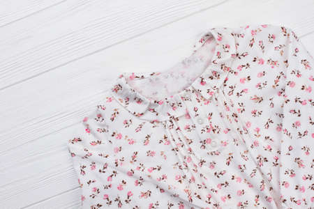 Girls blouse with flower pattern. Stylish top with collar and button-up neck. Beautiful clothing for romantic mood.