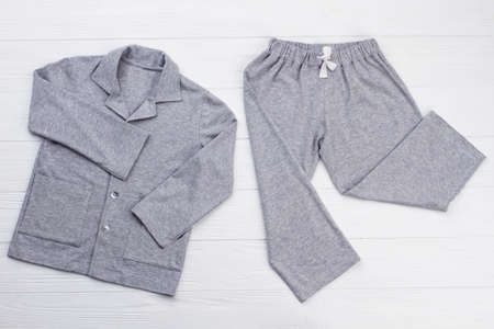 Boys pajama set on white. Soft gray melange cotton. Loose-fitting shirt and pants for comfort rest at night.