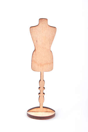 Mannequin wood cutout, white background. Female figure mannequin standing on white background.