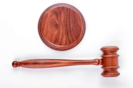 Wooden judge gavel with stand. Wooden gavel and stand on white backgrround. Auction and law, business concept.