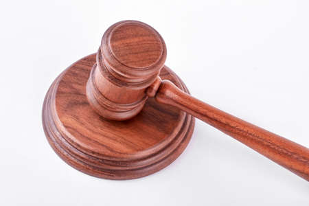Wooden gavel and stand. Judge gavel and stand over white background. Law, business, auction.