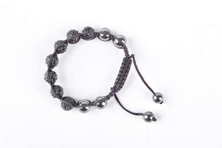 Shamballa bracelet isolated on white background. Buddhist bracelet shamballa with gems on a white background.