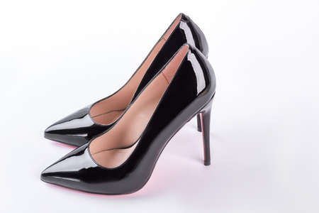 Classic black shoes for woman. Elegant high heeled shoes isolated on white background. Female fashion footwear.