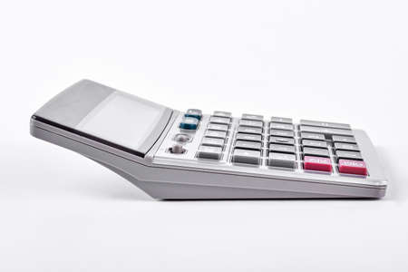 Plastic electronic calculator on white background. New silver calculator isolated on white background. Stock Photo