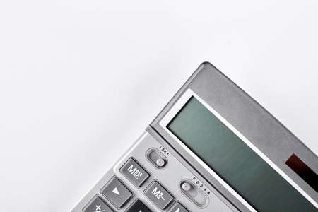 Grey electronic calculator, cropped image. Silver digital calculator isolated on white background.