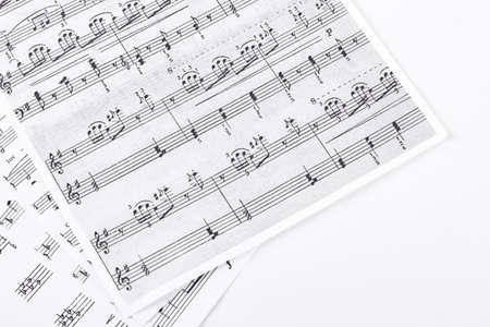Music sheets on white background. Sheets with musical notes isolated on white background. Archivio Fotografico