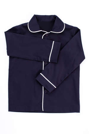 Dark blue shirt on white. Pajama garment with rounded collar decorated with edging. Stylish nightwear for boys.