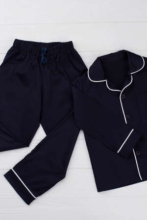 Black sleepwear set for boys. Simple design with rounded elements. Soft texture of cotton fabric. Stock Photo