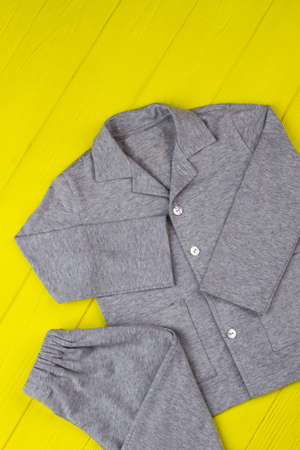 Gray pajama set for boys. Loose pants and shirt made of soft cotton. Warm and comfy for winter nights.