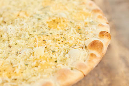 Cheese pizza crust close up. Pizza crust and shredered cheese close up