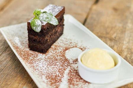Cake with mint floured with white powder. Fucused piece of cake. Stock Photo