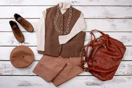 Set of female fashion outfit. Women vest with sweater, trousers and accessories. Women elegant clothes set.