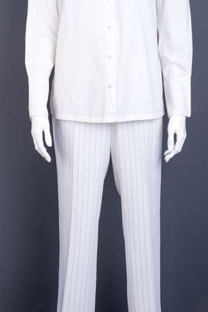 White striped trousers for women. White cotton shirt for women. Designers clothes for ladies. Stock Photo