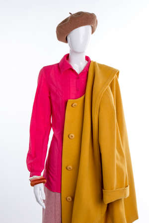Blouse, coat and beret for women. Female brown beret and yellow cashmere overcoat. New collection of feminine autumn clothing.