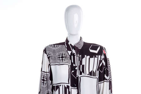 White patterned blouse for women. Female mannequin in long sleeve buttoned shirt. Feminine casual clothing.