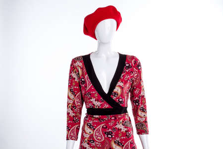 Mannequin portrait with red garment. White isolated background.