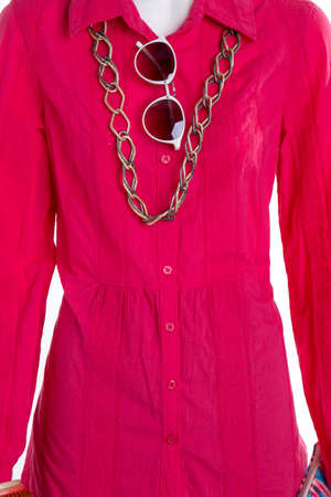 Close up red woman shirt. Spectacles with chain necklace.