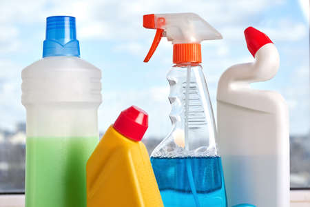 Set of products for home cleaning. Close up four bottles for house cleaning. Eco cleaning concept. Stock Photo