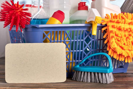 Detergents and tools for cleaning. Cleaning kit in basket. Concept of tidiness at home. Stock Photo