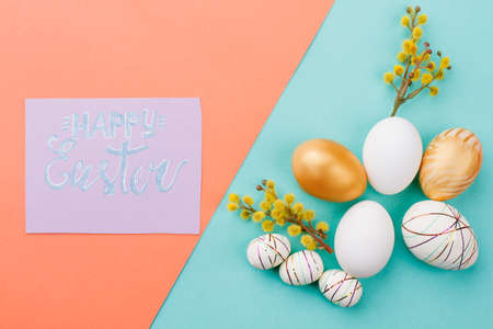 Happy Easter congratulatory card. Various design Easter eggs decorated with pussy willow on colored background. Best wishes for Easter holidays.