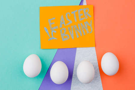 Easter Eggs And Text Easter Bunny White Eggs On Colorful Background