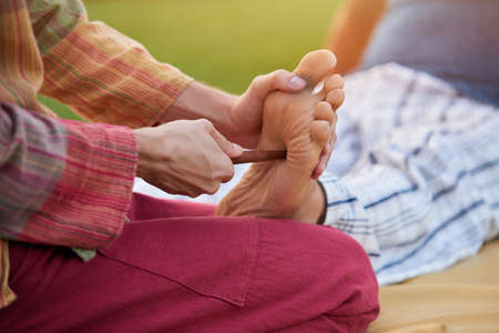 Leg thai massage. Man getting reflexology foot thai massage.