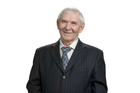 Portrait of smiling senior businessman. Happy old man in black suit and tie, white isolated background.