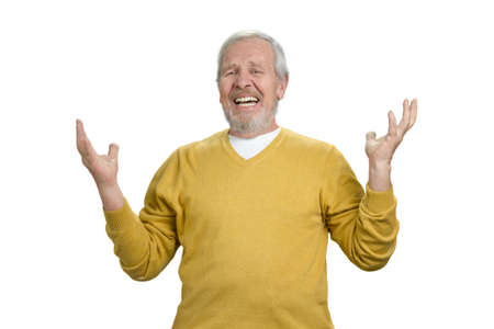 Portrait of disappointed old man. Hands up. White isolated background.