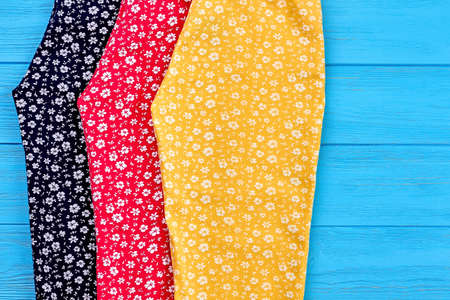 Detail of organic baby summer trousers. Collection of natural colorful summer pants for kids close up. Stock Photo