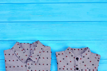 High quality brand shirts for toddler boys. Grey cotton dotted shirts for children, copy space. New collection of modern apparel for little boys.