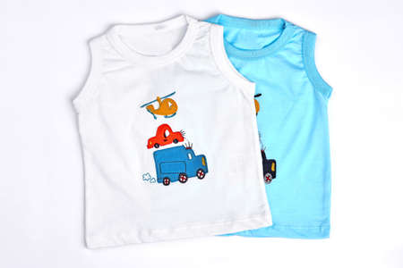 Collection of new t-shirts for baby-boys. White and blue cartoon sleeveless t-shirts for infant boys. Toddler boy high quality summer cartoon t-shirts. Foto de archivo - 99513880
