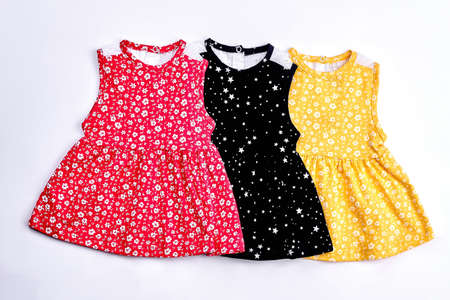 Set of beautiful tops for toddlers girls. Baby-girls colored patterned tops for casual wear. Sleeveless sundresses for infant girls.