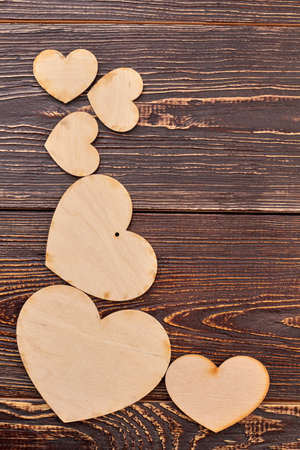 Beautiful wooden hearts and copy space. Handmade plywood hearts for decoupage on textured wood. Valentines Day wooden craft. Stok Fotoğraf