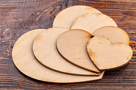 Close up wooden hearts for decoupage. Hearts carved from wood. Vintage style decorative items from wood. Stok Fotoğraf