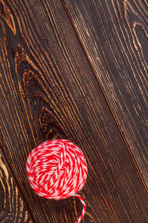 Ball of woollen threads, copy space. Ball of yarn for knitting on textured wooden background, top view.