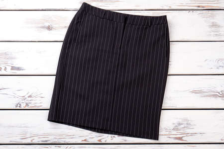 Business style black skirt. New brand classic skirt for women. Female elegance and fashion.