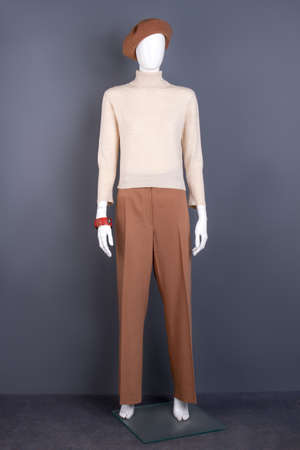 Mannequin dressed in turtleneck sweater and trousers. Full length female mannequin in modern autumn outfit. Feminine trendy wardrobe.