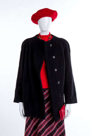 Female red beret, sweater and wallet. Female mannequin clothed in hat, overcoat and skirt. Ladies elegant clothes and accessories.