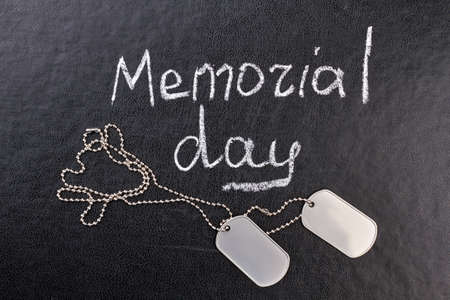 Memorial day concept, dog tags. Black leather background. Stock Photo
