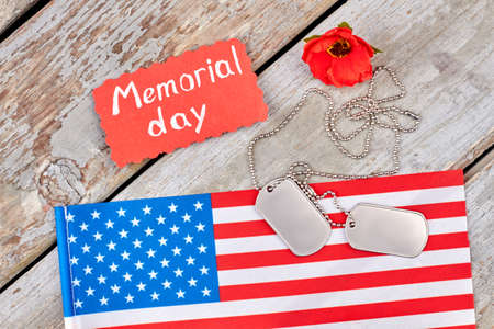 Symbols of memorial day. Flag of united states, dog tags, and red poppy. Stock Photo