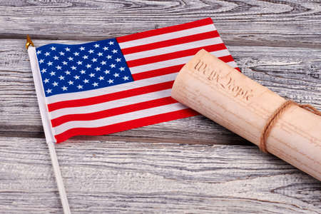 USA cocktail flag and constitutional document. Constitution of United States of America and constitution on rustic wooden background.