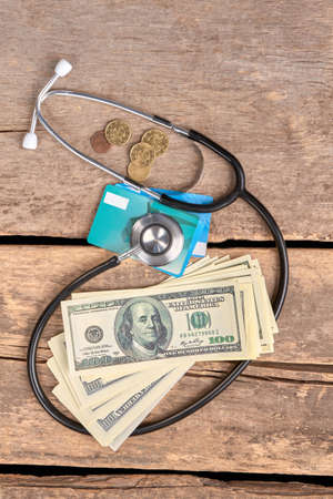 Health costs money concept. Stethoscope, money, coins and credit cards concept. Stock Photo