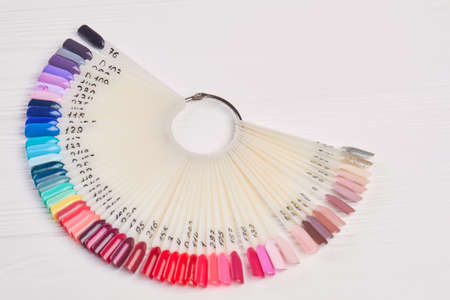 Nail color samples in different colors. Big collection of artificial finger nails painted in different coolors. Nail beauty salon. Stok Fotoğraf
