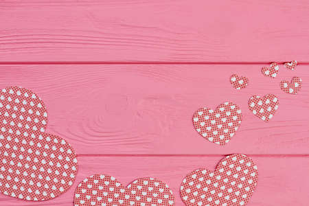 Collection of paper hearts on wooden background. Set of handmade paper cutouts for Valentines Day and copy space. Valentines holiday greeting card.