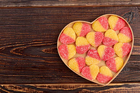 Heart shaped candies in box, copy space. Tasty gift for Valentines holiday, top view. Happy Valentines Day. Stok Fotoğraf