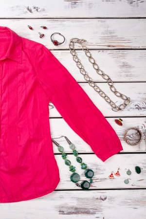Pink shirt, jewellery necklaces, rings. Outfit of red woman dress with jewelry accessories. Reklamní fotografie