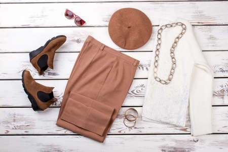 Fashionable womens clothes on the table. Set of autumn female garment.