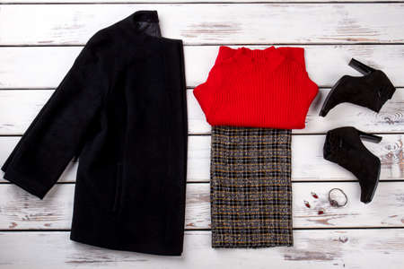 Womens winter clothes. Folded red sweater.