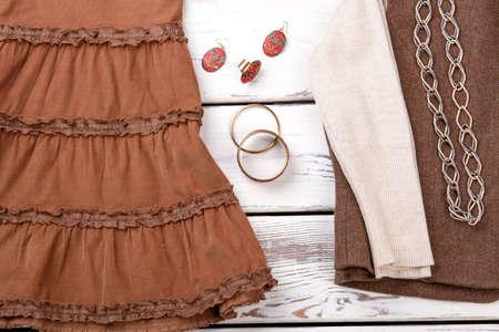 Womens autumn clothes and accessories, close up. Braceletes with earrings. Imagens